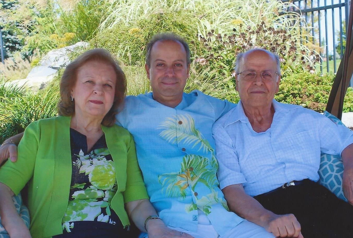 Joseph Eid with his parents